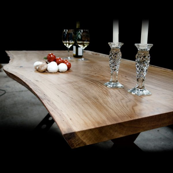 Beautiful bespoke solid wooden table top with unique live edging and rustic styled ornaments on top