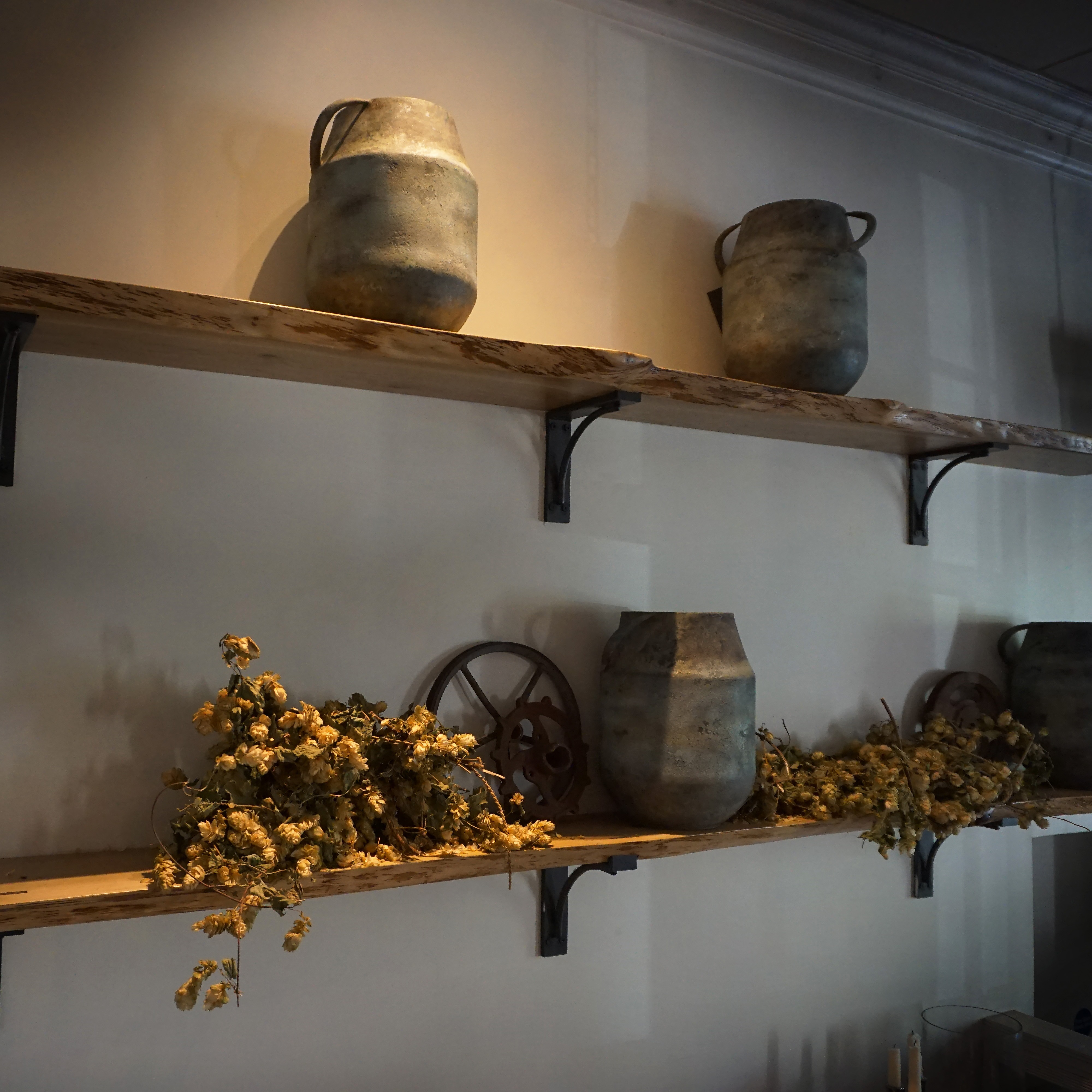 Beautiful bespoke live edged oak shelving with rustic decor