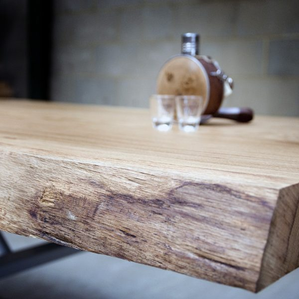 Beautiful bespoke live edging detail showing earthy organic grains on large oak table