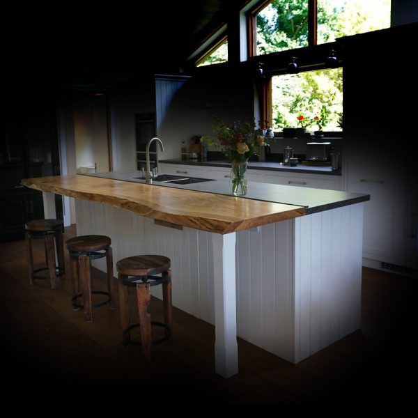 Beautiful bespoke rustic edged oak breakfast bar in modern contemporary kitchen