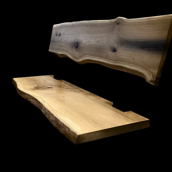Bespoke waney edged oak bench top with custom cutouts and resin infused knots, cracks and striations