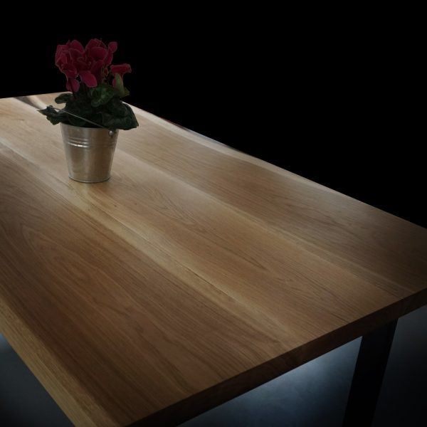 Modern contemporary oak desk top showing unique earthy garins and resin infused natural imperfections