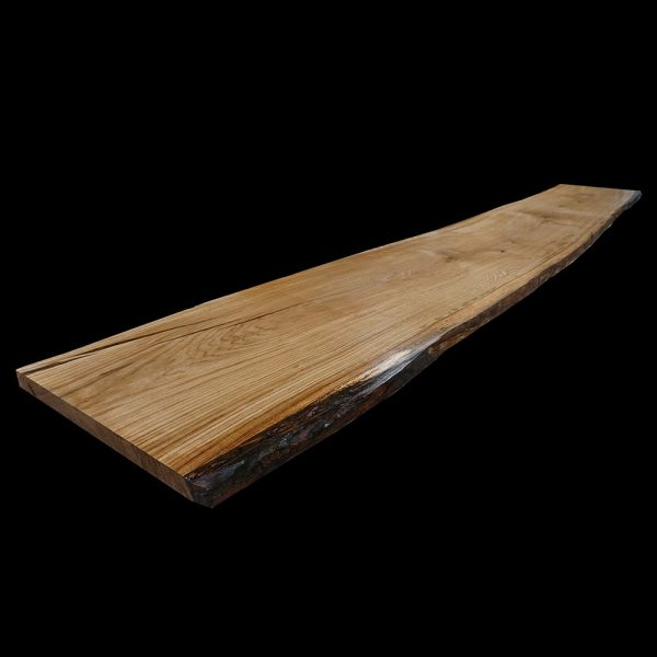 Beautiful bespoke long oak table top with unique resin enhanced edges showing beautiful earthy wooden grains and live edging