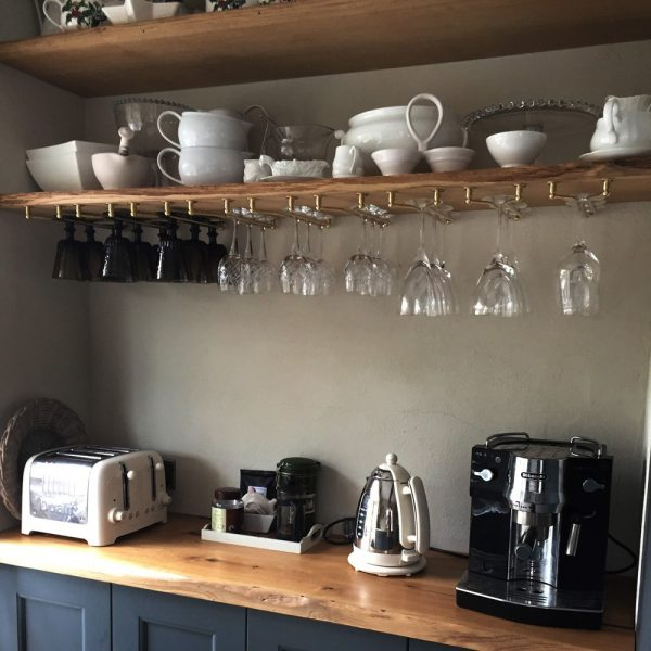 Bespoke modern contemporary styled live edged oak shelving with modern kitchen equipment and crockery