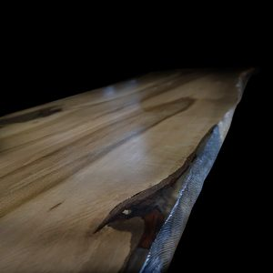 Glassy resin effect on live edged earthy oak table top slab