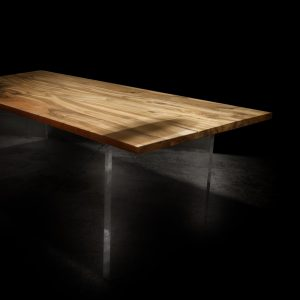 Bespoke wild walnut desk top with modern contemporary straight edging infused with resin and featuring acrylic panel legs