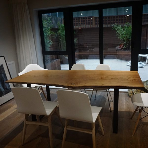 Beautiful modern contemporary dining room with live edged oak table