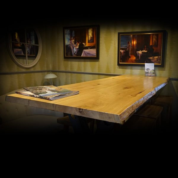 Live edged rustic oak desk table top with glassy resin infused natural imperfections