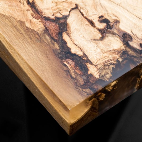 Beautiful resin infused edging showing gorgeous natural imperfections on oak desk top