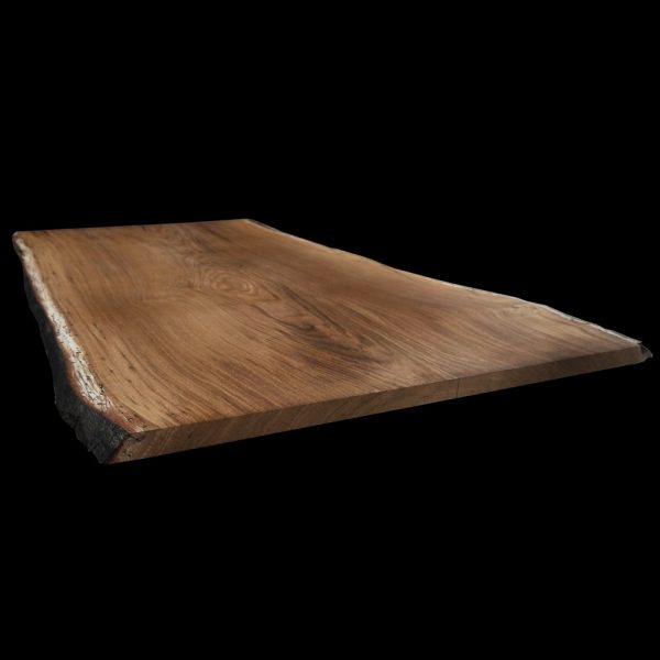 Beautiful live natural edged oak slab table top showing beautiful earthy grains and vibrant colourings