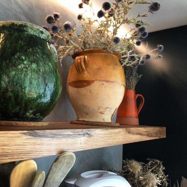 Beautiful oak shelving showing unique earthy grains with artistic ornaments