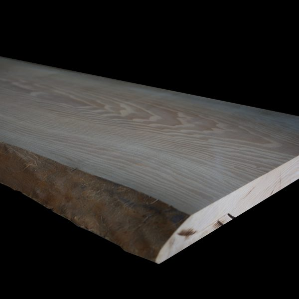 Beautiful unique grain detail of bespoke modern ash slab top with live edges