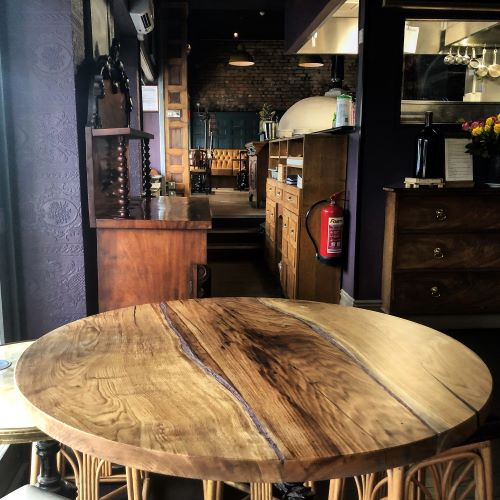 round oak table with copper features by Earthy Timber