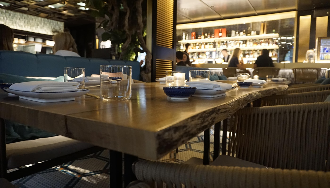 Beautiful bespoke live edge oak dining table in modern contemporary restaurant