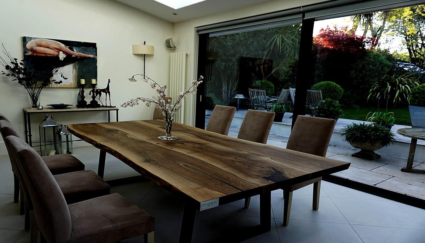Beautiful bespoke live edge oak dining table in modern contemporary restaurant