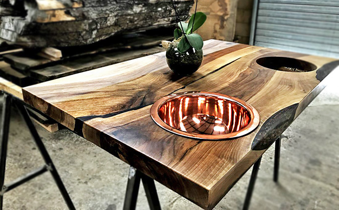 Beautiful rose gold rounded sink in wild walnut resin enhanced bathroom worktop