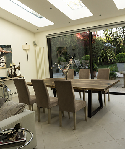Large walnut waney edged resin infilled bespoke dining table in modern dining room