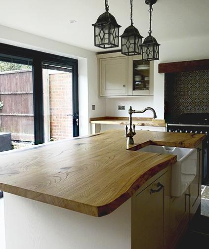Waney edge rustic oak kitchen island in beautiful modern kitchen