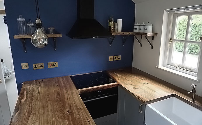Beautiful earthy solid oak kitchen worktops in modern styled kitchen cottage