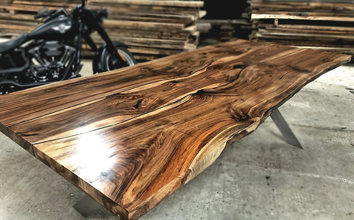 Beautiful bespoke wild walnut waney edged dining table