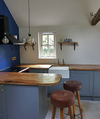 Bespoke solid wood luxury hand-crafted oak worktops in modern contemporary kitchen
