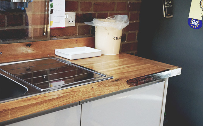 Beautiful resin filled straight edging of oak worktop in modern contemporary kitchen