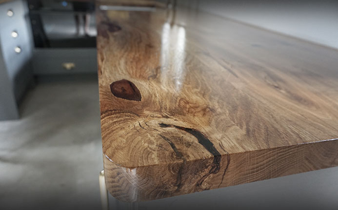 Rounded edge of beautiful oak earthy resin filled worktops