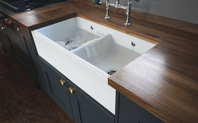 Beautiful earthy grainy oak worktops expertly fitted around modern sink