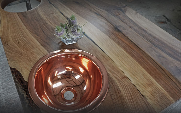 beautiful earthy grain of bark preserved wild walnut sink top with copper basin
