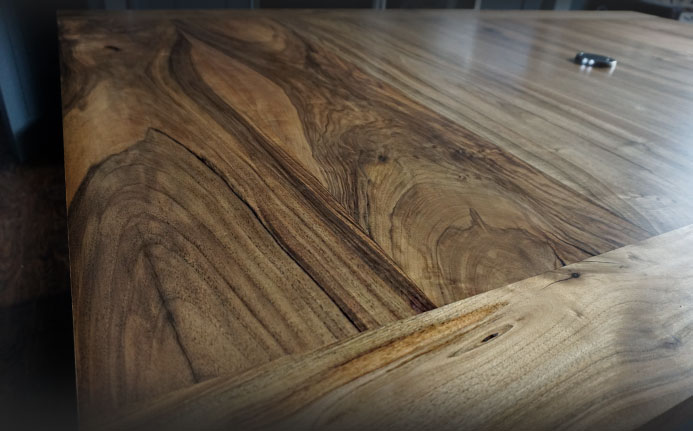 Earthy grain of beautiful natural glossy finished wild walnut kitchen island