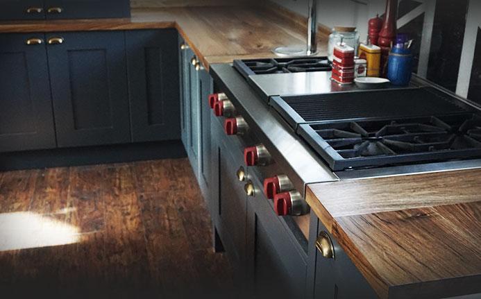 Beautiful organic earthy wild walnut worktops with beautiful modern kitchen appliances