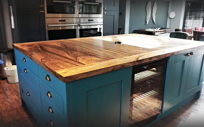 Bespoke earthy wild walnut kitchen island in beautiful spacious modern kitchen
