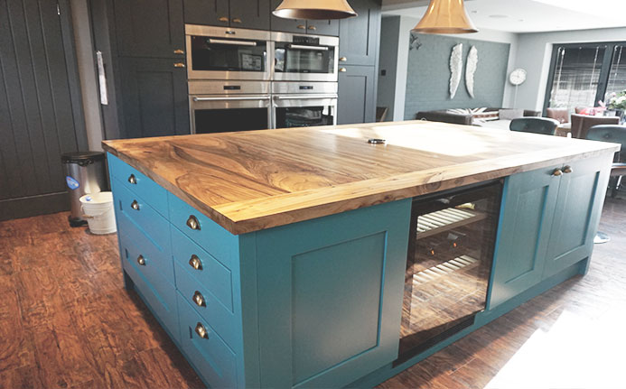 Bespoke solid oak grainy kitchen island in modern contemporary kitchen